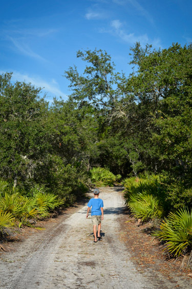 HIking at Camp Helen State Park along Florida's 30A.