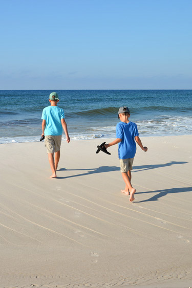 Brothers playing on the beach along Florida's 30A.