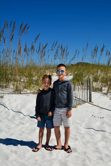 Two brothers standing on the beach at Grayton Beach State Park.