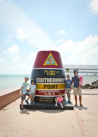 Family posing at Southernmost Point in Continental US