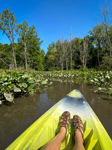 Kayaking through channel at Indiana's Chain O' Lakes State Park