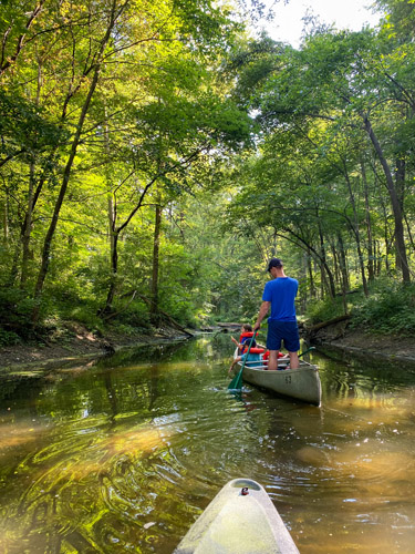Canoeing through channel at Indiana's Chain O' Lakes State Park