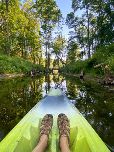 Kayaking in channel at Indiana's Chain O' Lakes State Park