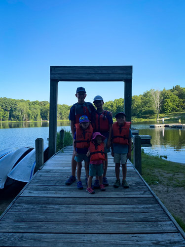 Five siblings on dock before paddling at Indiana's Chain O' Lakes State Park.