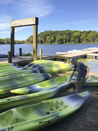 Boy getting a kayak at Chain O' Lakes State Park boat rental