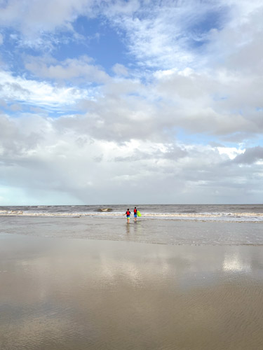 Two boys playing in the surf at Jekyll Island's Great Dunes Beach Park.