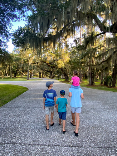 Four children walking on a path in Jekyll Island's Historic District.