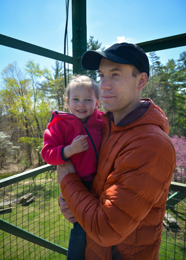 Father holding daughter while taking in the view from Brown County Fire Tower.