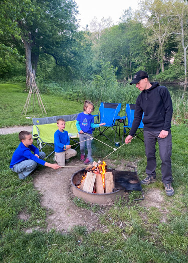 Family roasting marshmallows at White River Campground campsite.